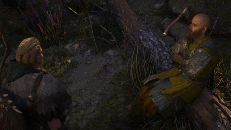 Eivor z wikingiem, który ma topór w głowie