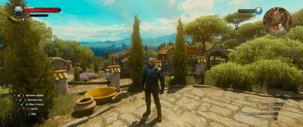 Wiedźmin Geralt stojący na placu w grze Wiedźmin 3: Krew i Wino