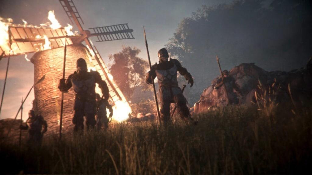 Bohaterowie z włóczęgami z A Plague Tale: Innocence, a za nimi palący się młyn