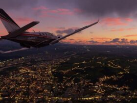 Samolot lecący o zachodzie słońca.